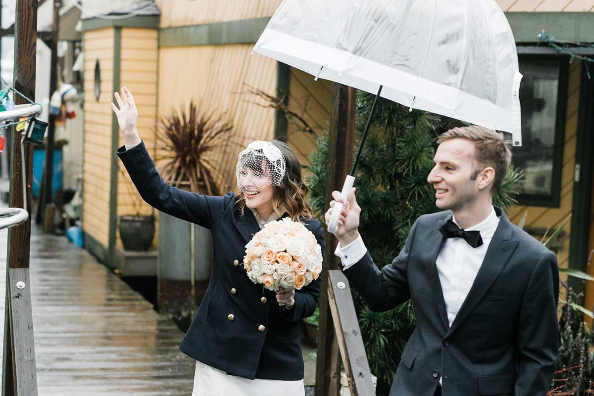 Chris and Amber wave to their neighbors before their Canlis wedding in Seattle.