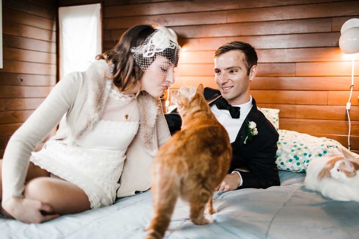 Chris and Amber relax in their floating home with their cat Hefner at their floating home in Seattle.