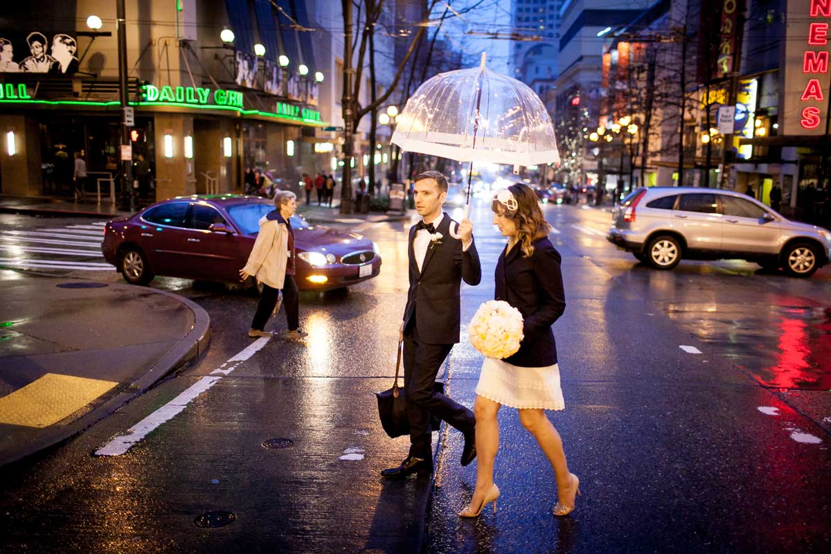 Chris and Amber walk through Downtown Seattle before their wedding at Canlis.