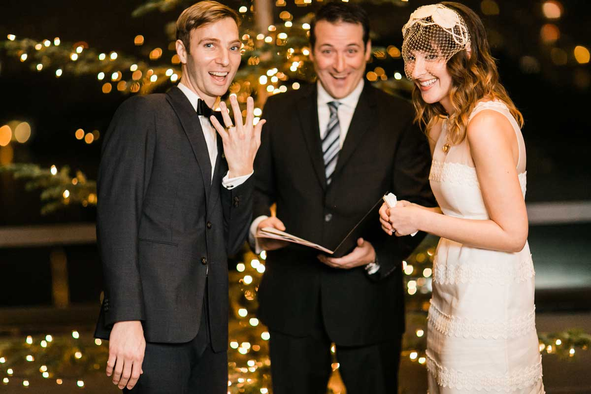 Chris shows off his ring after his wedding ceremony at Canlis in Seattle.