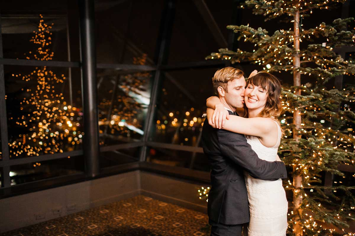 Chris and Amber kiss after being pronounced married at their wedding at Canlis in Seattle.