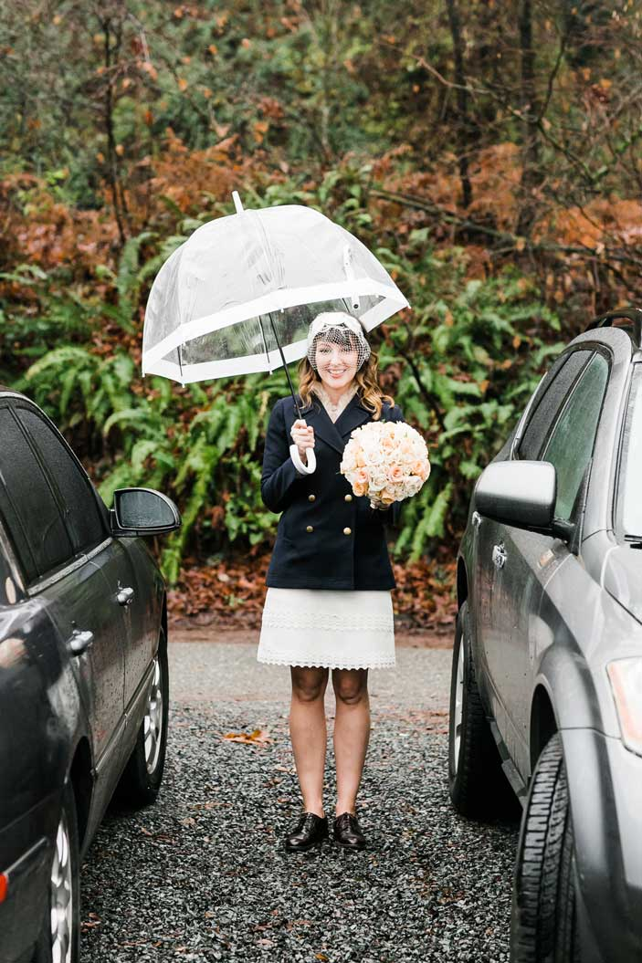 Amber waits for Chris under an umbrella before their wedding at Canlis.