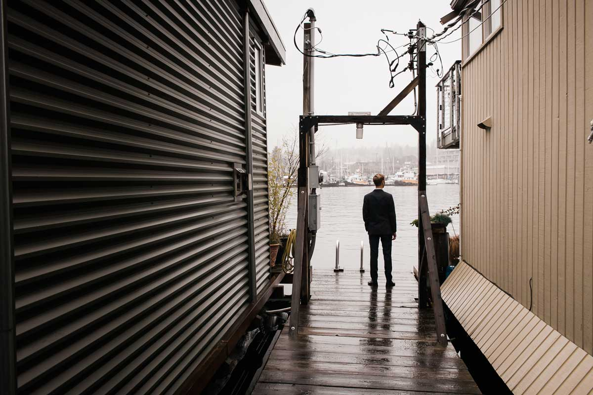 Chris waits for Amber on the dock for his Lake Union Floating home during their first look.