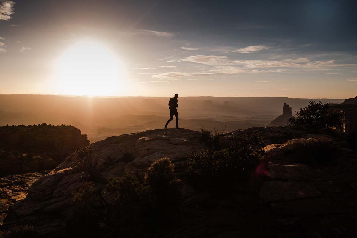 Luca Mobley exploring Canyon Lands National park while traveling in his sprinter van.