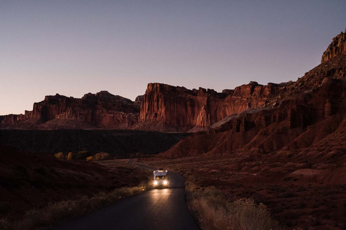 Kathryn and Lucas driving through Capitol Reef National Park in their Sprinter van photographing the Southwest.