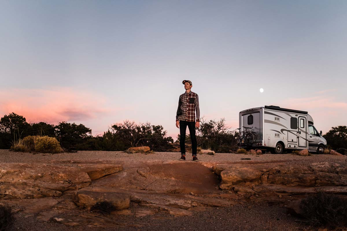 Lucas Mobley infront of his Pleasure Way rv in Canyon Lands National Park.