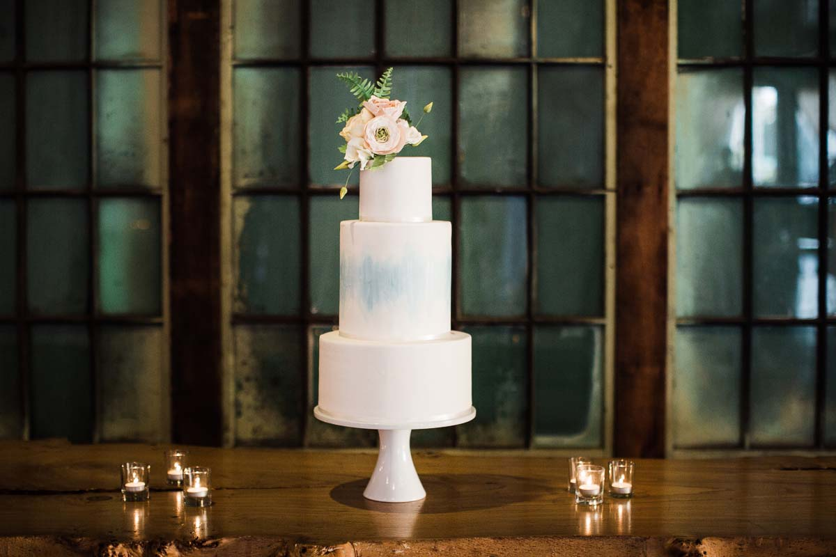 A cake by Honey Crumb Cake Studio at a wedding at Sodo Park