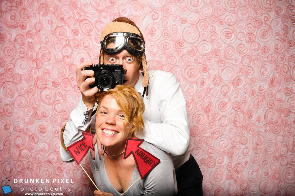 Lucas Mobley and Kathryn in a photo booth.