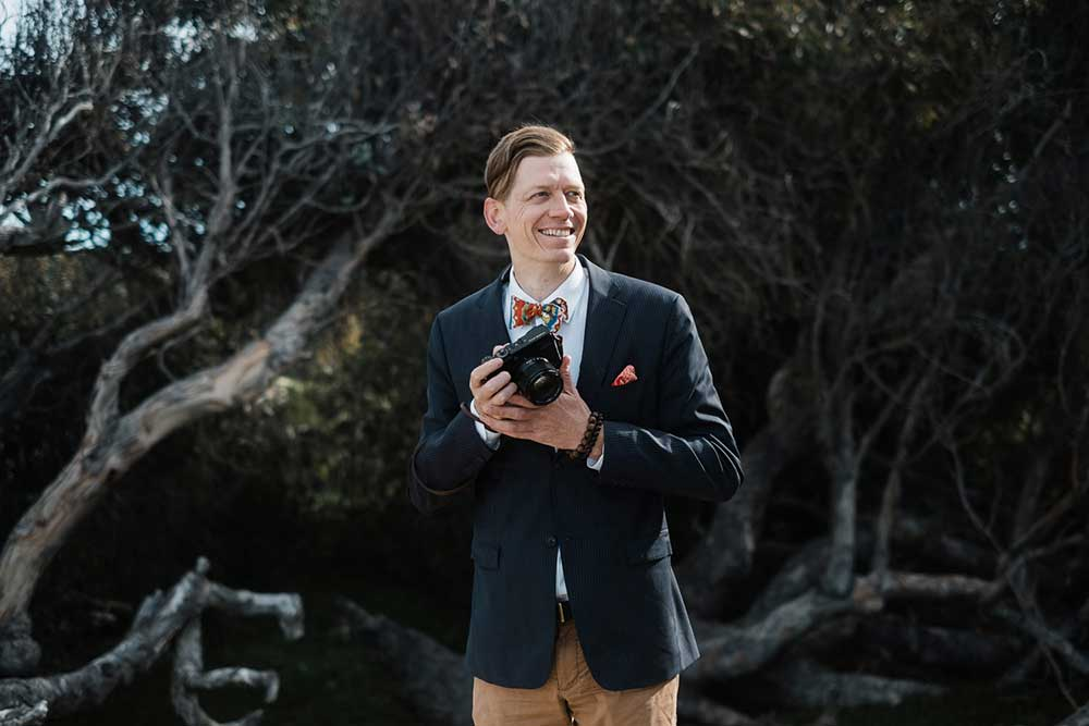 Portrait of Seattle Wedding Photographer Lucas Mobley. He is the owner at Lucas Mobley Photography Inc.
