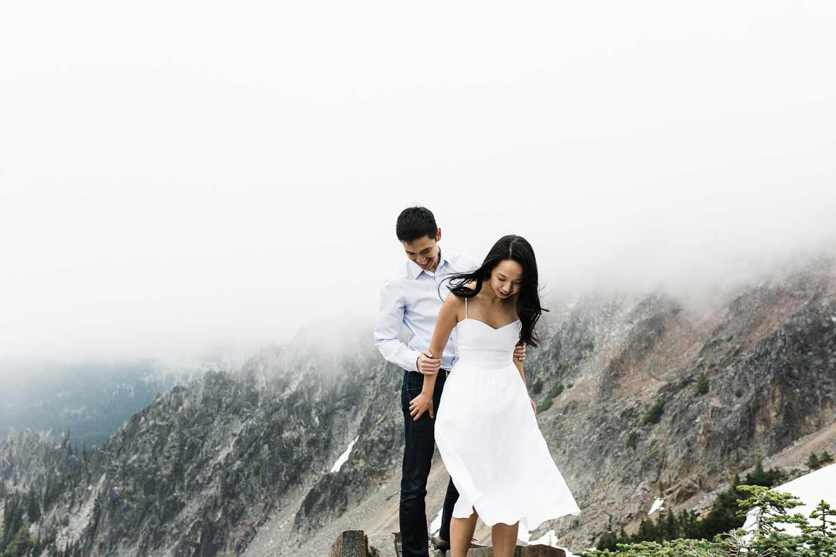 Fog at Sunrise visitor center during their engagement session