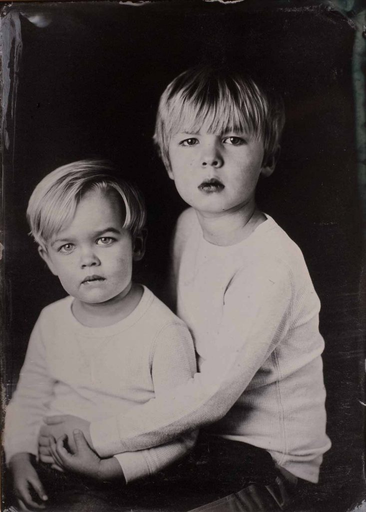 Two young brothers in a tintype photo.
