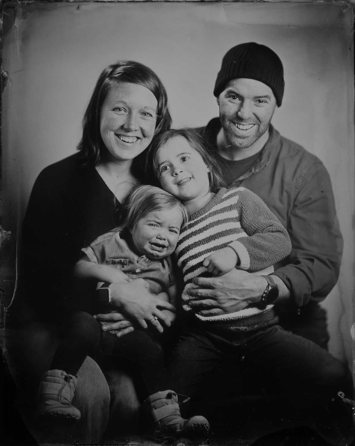a family of 4 people in a tintype photo
