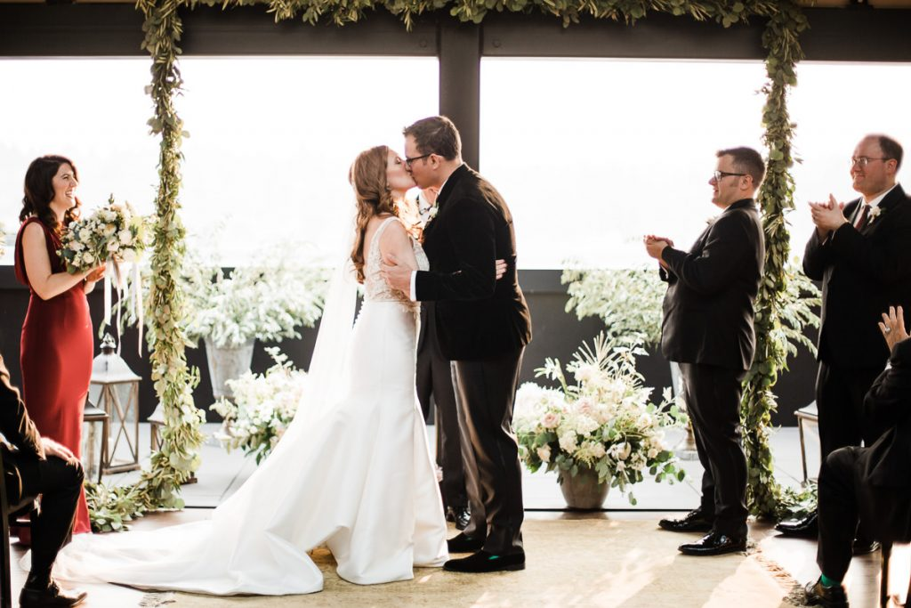 Alina and Tony during their wedding ceremony at the Olympic Rooftop Pavilion during their wedding.