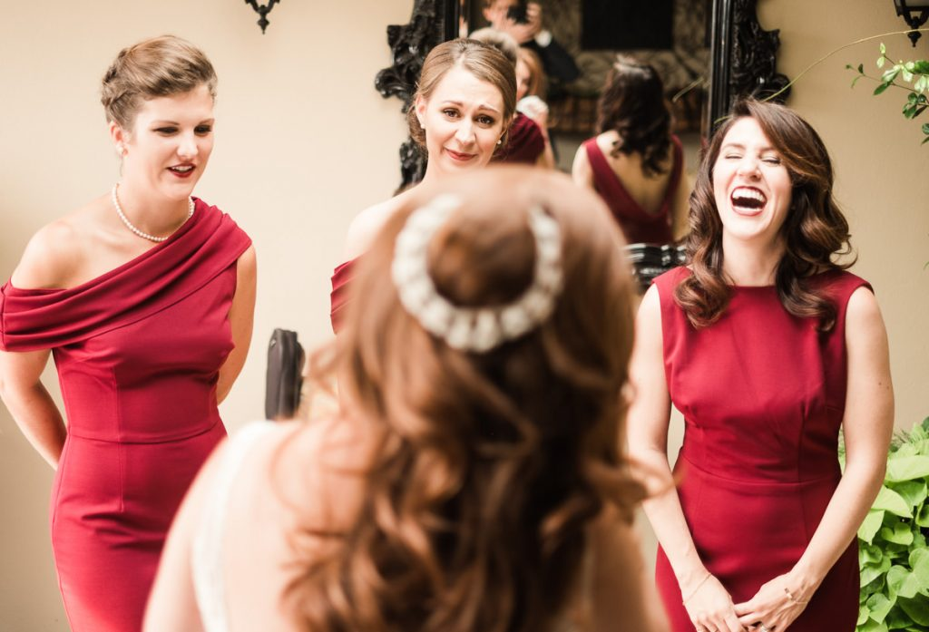 Alinas bridesmades react to her at her Seattle wedding at the Olympic Rooftop Pavilion.