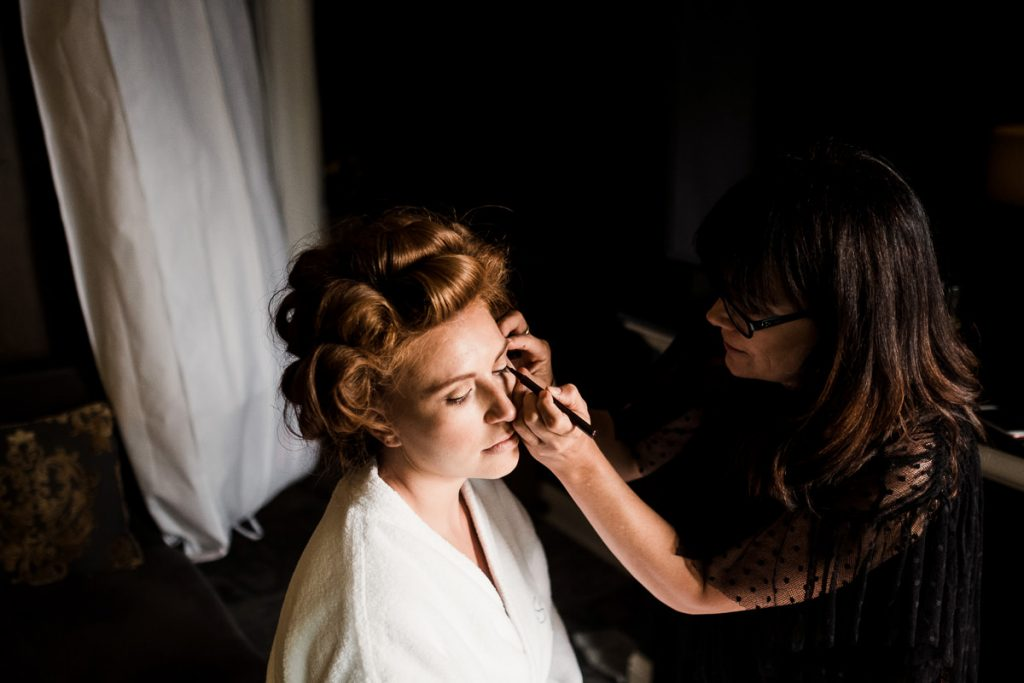 Alina get her make up fonished before her wedding at the Olympic Rooftop Pavilion in Seattle.