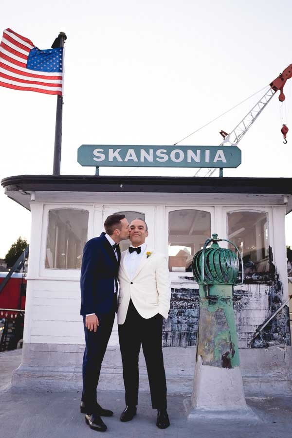 A gay couple during their wedding at Skansonia.